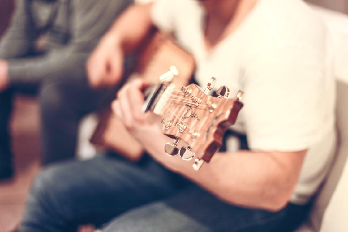 man-person-sitting-playing